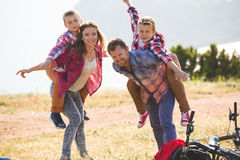 Family of four people riding bikes in the mountains Stock Images