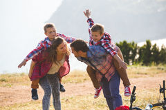 Family of four people riding bikes in the mountains Royalty Free Stock Photos