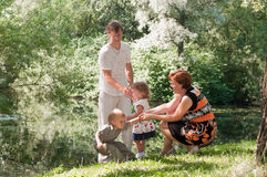 Family a four people in summer park Royalty Free Stock Image