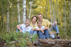 Family of four picking Stock Images