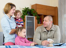 Family of four planning budget Royalty Free Stock Image
