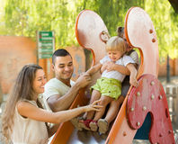 Family of four at playground Royalty Free Stock Photos