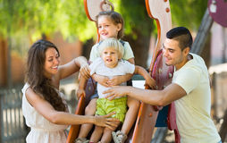Family of four at playground Stock Image