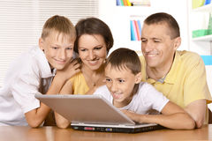 Family of four playing Royalty Free Stock Photography
