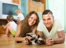 Family of four playing with kitten Stock Photography