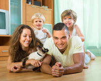 Family of four playing with kitten Royalty Free Stock Image