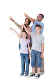 Family of four pointing at copy space Royalty Free Stock Image