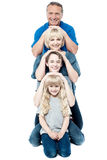 Family of four posing in a row Royalty Free Stock Photography