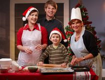 Family of four preparing for christmas Royalty Free Stock Photo