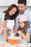 Family of four preparing cookies in the kitchen Royalty Free Stock Photos