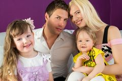 Family of four in the purple room. Portrait of a family of four in the purple room royalty free stock photography