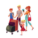 Family of four pushing luggage cart at airport, travelling together Stock Image
