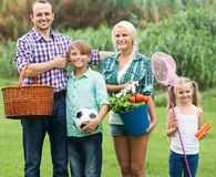 Family of four resting at countryside Stock Photography
