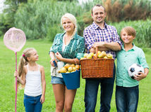 Family of four resting at countryside Royalty Free Stock Photos
