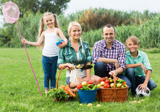 Family of four resting at countryside Royalty Free Stock Image