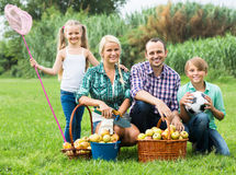 Family of four resting at countryside Royalty Free Stock Photography