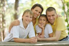 Family of four resting Stock Images