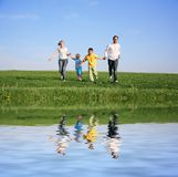 Family of four running Royalty Free Stock Photos