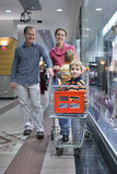 Family of four in shop Royalty Free Stock Photo