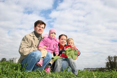 Family of four sit Royalty Free Stock Photo