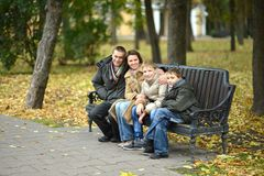 Family of four sitting Stock Image