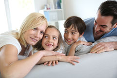 Family relaxing in sofa Royalty Free Stock Photo