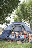Family Of Four Smiling In Tent Royalty Free Stock Photos