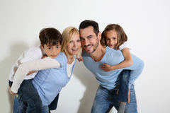 Parents holding kids on their back Stock Photography