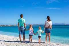 Family of four during summer beach vacation Stock Image