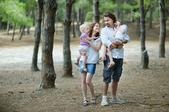 Family of four at summer day Stock Images