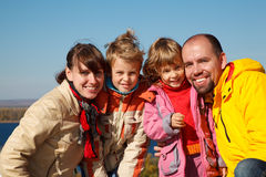 Family of four sunny autumn day Royalty Free Stock Photo