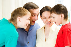 Family of four talks. Family of four standing together and surprise talks Royalty Free Stock Images