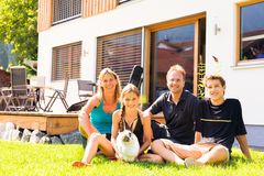 Family Of Four In Their Back Yard royalty free stock images