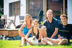 Family Of Four In Their Back Yard Stock Images