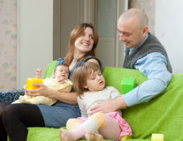 Family of four together with newborn Stock Photo