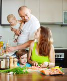 Family of four together  prepares seafood Stock Images
