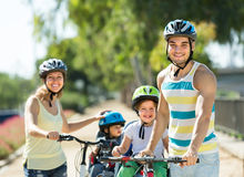 Family of four traveling by bicycles Royalty Free Stock Photos