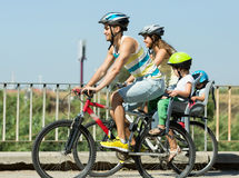 Family of four traveling by bicycles Stock Photo