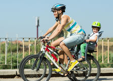Family of four traveling by bicycles Royalty Free Stock Images
