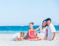 Family of four on tropical beach Royalty Free Stock Photography