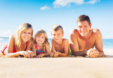 Family of Four on Tropical Beach Stock Images