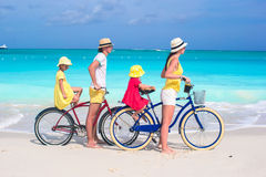 Family of four with two kids during beach summer Stock Images