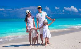 Family of four with two kids during beach summer Royalty Free Stock Images