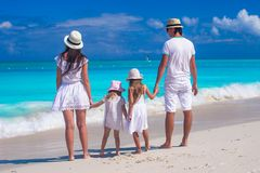 Family of four with two kids during beach summer Royalty Free Stock Photos