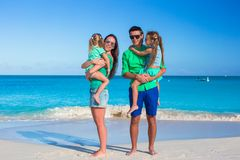 Family of four with two kids during beach vacation Stock Images