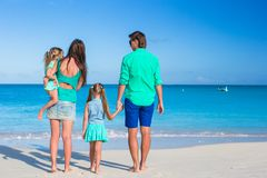 Family of four with two kids during beach vacation Royalty Free Stock Photo