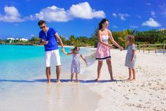 Family of four with two kids during beach vacation Royalty Free Stock Images