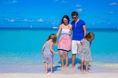 Family of four with two kids during beach vacation Stock Photos