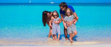 Family of four with two kids during beach vacation Royalty Free Stock Image