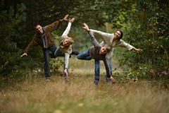 Family of four walking Stock Photography